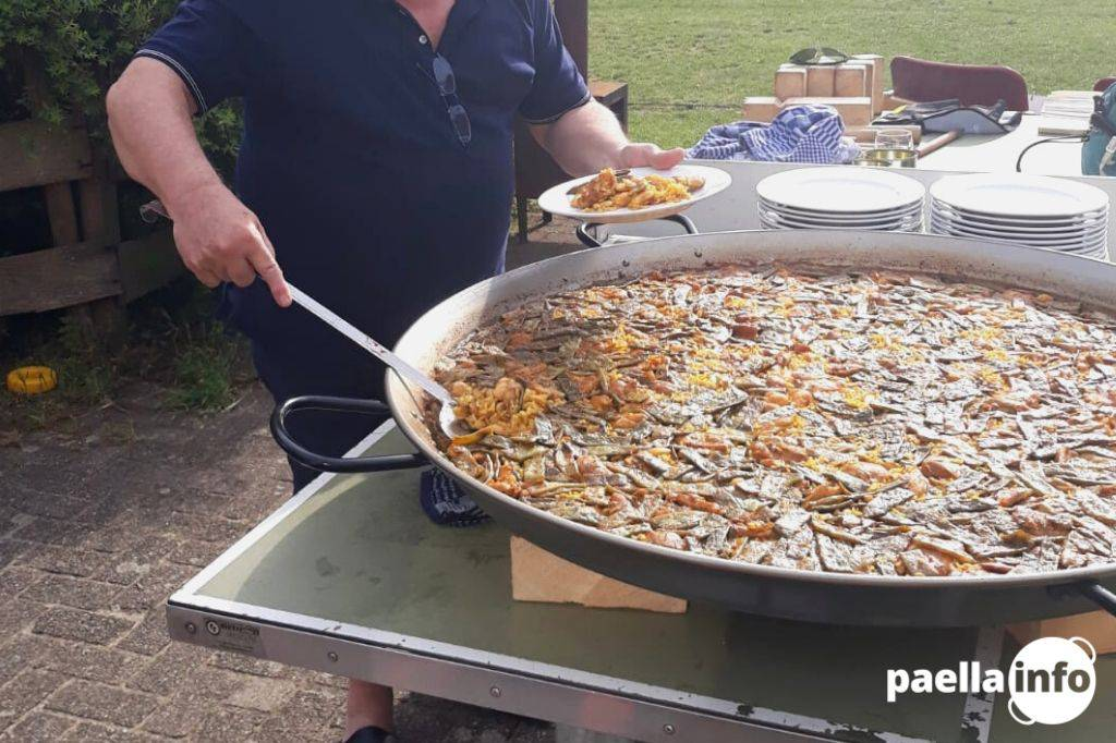 How is paella being served Featured